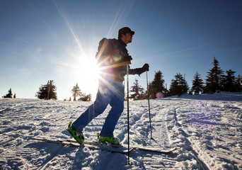 Cross-country skier - snowy mountains in the background