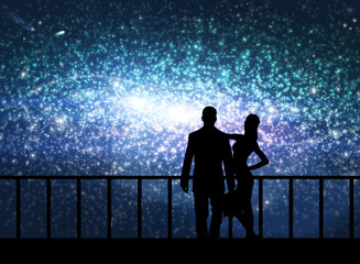 Silhouette of couple stand in cosmos