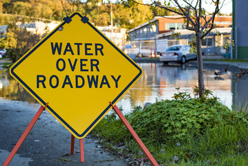 Water Over Roadway Street Sign