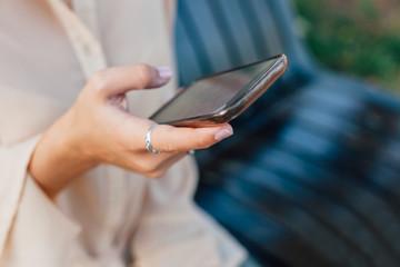 Closeup of girl using smart phone