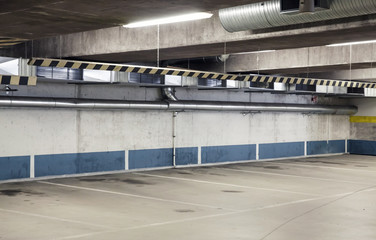 Empty urban parking interior, concrete walls