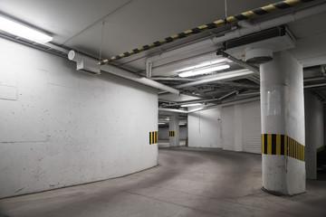 Empty underground concrete parking interior