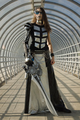 Futuristic girl holding a blade