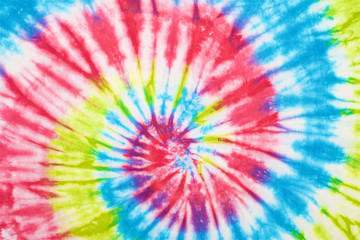 close up shot of spiral tie dye fabric texture background