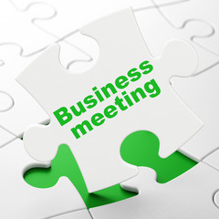 Business concept: Business Meeting on puzzle background