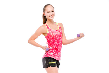 Young sportswoman exercising with weights