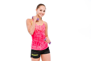 Young sportswoman exercising with dumbbells