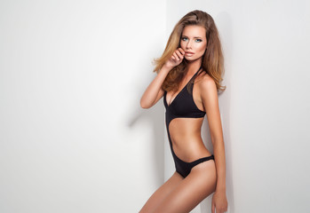 Fashion photo of sexy skinny slim woman wearing black underwear