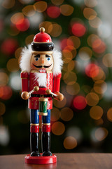 Christmas: Traditional Wooden Nutcracker With Tree Behind