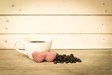 cup of coffee and coffee seed with two red heart ,vintage tone