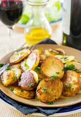Fried potatoes with goose duck grease and parsley