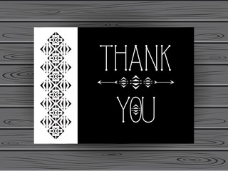 Thank you card in black and white with geometric ornament on wood background