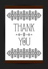 Thank you print in wooden frame on subtle background.