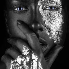 Acrylic Prints fashion portrait of a dark-skinned girl with silver foil make-up