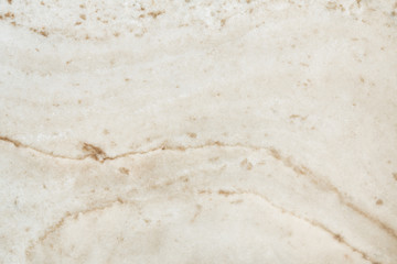 Cream colored marble patterned texture background