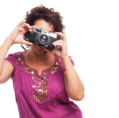 portrait of a  mature woman taking photos with her camera on a white background