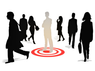 Targeting perfection .Business man standing on a target among a group of competitors isolated on a white background. Focusing on strategy,goals or success concept.