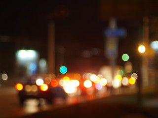 Defocused image of traffic on night city street