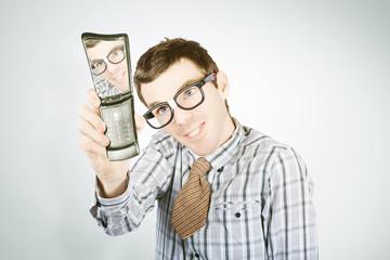 Social networking nerd taking self portrait