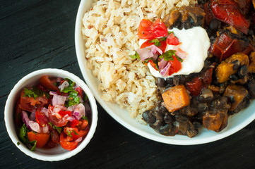 Vegetable feijoada. A vegetarian version of the popular Brazilian dish made with black beans, butternut squash and served with rice and salsa.