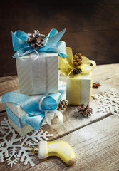 Christmas Boxes with gifts, blue and gold bows, snowflakes, pine