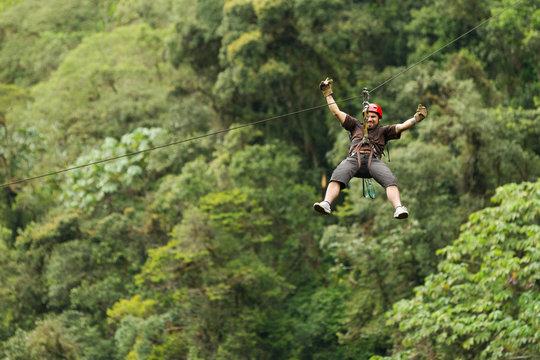 zipline line zip canopy jungle adventure forest rainforest ecuador people adult male zipline exploration in ecuadorian rain forest zipline line zip canopy jungle adventure forest rainforest ecuador p