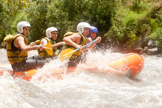 raft boat team rowing river ecuador group rapids whitewater nature competition partnership of powerful teenage human on a rafting boat patate flow ecuador shoot from water straight raft boat team row