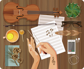 Workplace Music concept. Top view with textured table, feather, violin, bow, music paper, bass clef, treble clef, note, phone, tea, lemon, headphones, music, candy, lollipop, plant, hands