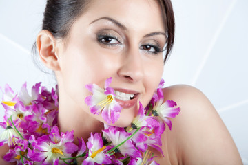 Young Beautiful Woman With Artificial Flowers