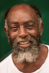 old man face elderly american portrait smiling african close afro warm look of an afro male smiling at camera old man face elderly american portrait smiling african close afro emotion outdoor outside