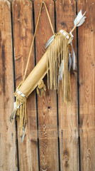tribal native american bow with feathers