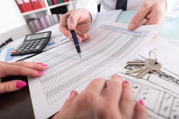 Estate agent showing a financial plan