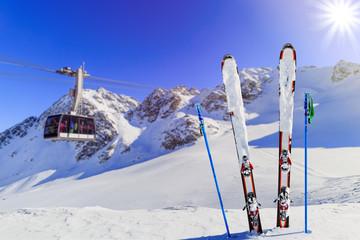 Winter season - ski equipments on ski run