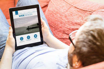 hipster on the sofa with webdesign tablet