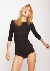 blond woman model posing in studio