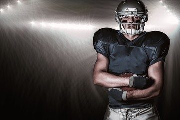 Portrait american football player with arms crossed
