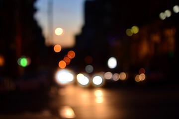 Evening city cars defocused lights background