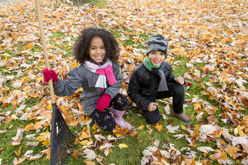 Childs on the leaf season. The autumn season