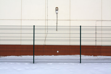 Color wall, fence and snow.