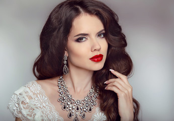 Portrait of a beautiful fashion bride girl with sensual red lips