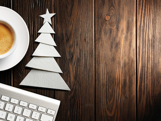 Christmas card. Keyboard, cup of coffee and Christmas tree made of paper