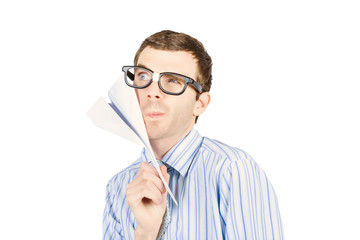 Business man devising trajectory with paper plane