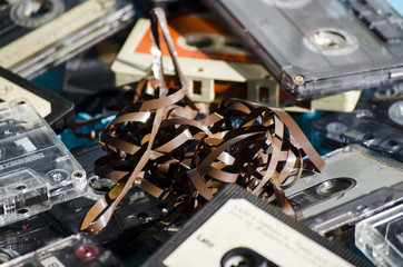 old cassette tapes on colored background