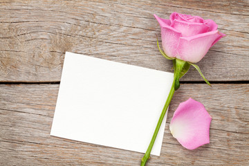 Valentines day greeting card or photo frame and pink rose