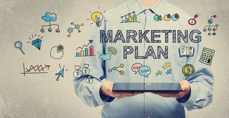 Marketing Plan concept with young man holding a tablet