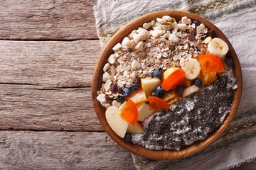 Healthy food: oatmeal with fruit and chia seeds. horizontal top view