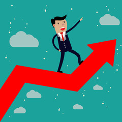 Businessman standing on a growing graph.
