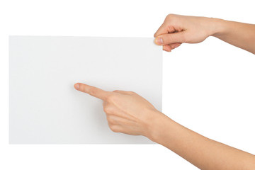 Womans hand pointing at blank paper