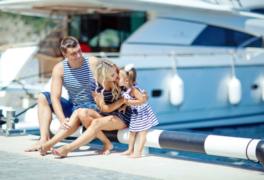 family near the yachts
