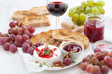 appetizers for wine - camembert with berry jam, toast and fruit